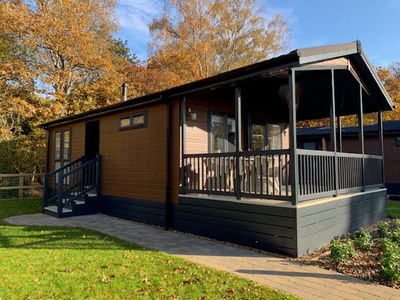 Lodge with covered veranda at Norfolk Woods